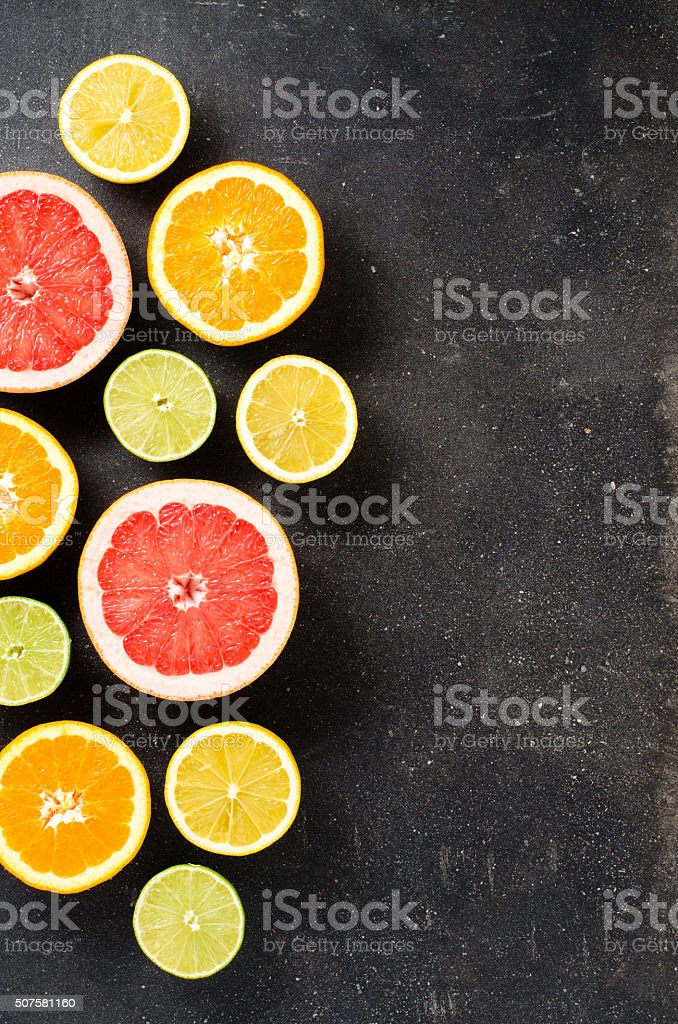 Mix of citrus fruits on dark table stock photo