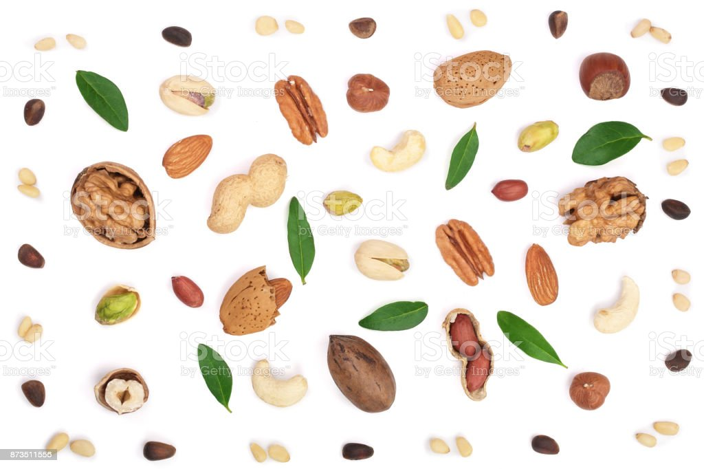 mix of different nuts with leaves isolated on white background, Flat lay pattern, Top view stock photo