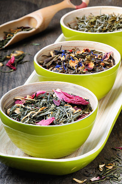 Mix of dry green and flower tea stock photo