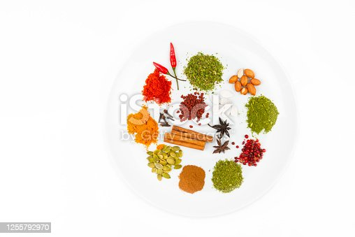 Image of a mix of flavored spices and herbs isolated on white background