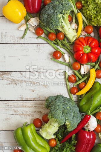 istock Mix of fresh seasonal vegetables on wooden background. Healthy eating concept. Plant based diet 1161713470
