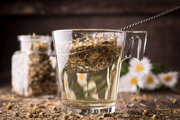 Mix of healthy herbal tea on vintage wooden background stock photo