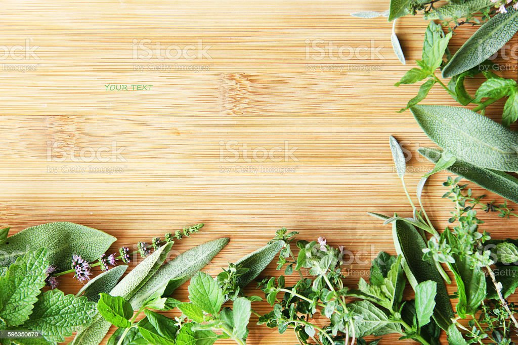 mix of herbs - sage, mint, thyme on wooden surface royalty-free stock photo
