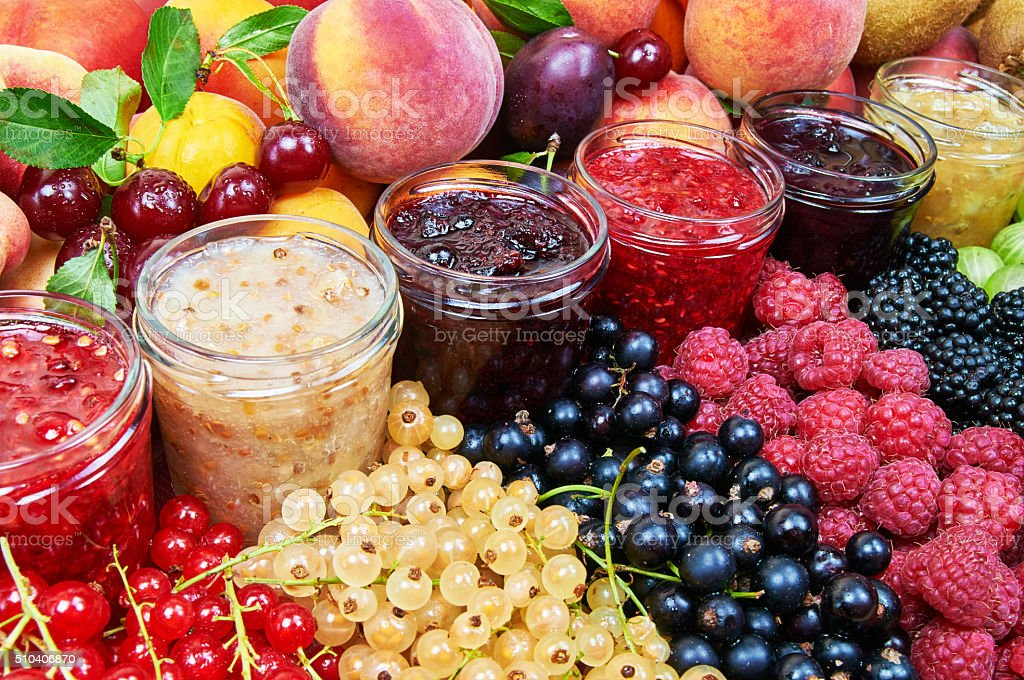 Mix of jams and fruits stock photo