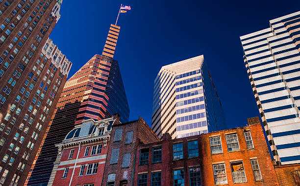 """Mix of modern and old buildings in Baltimore, MD """"Looking up at a mix of modern and old buildings in Baltimore, Maryland."""" baltimore maryland stock pictures, royalty-free photos & images"""