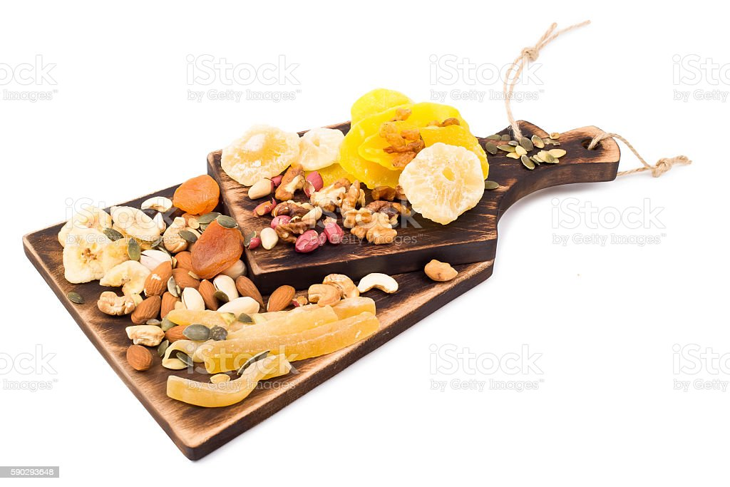 Mix of nuts and dry fruit on a wooden board royaltyfri bildbanksbilder