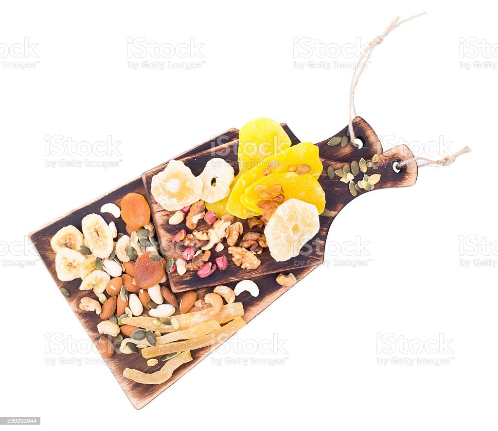 Mix of nuts and dry fruit on a wooden board Стоковые фото Стоковая фотография