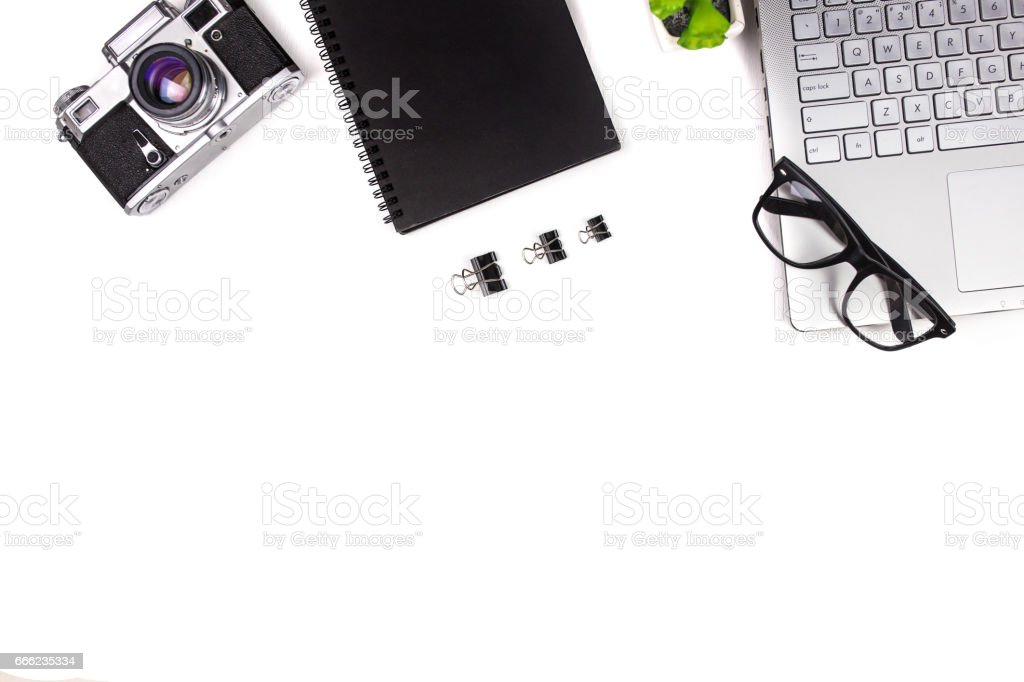 Mix of office supplies and business gadgets on a modern office desk, top view, flat lay stock photo