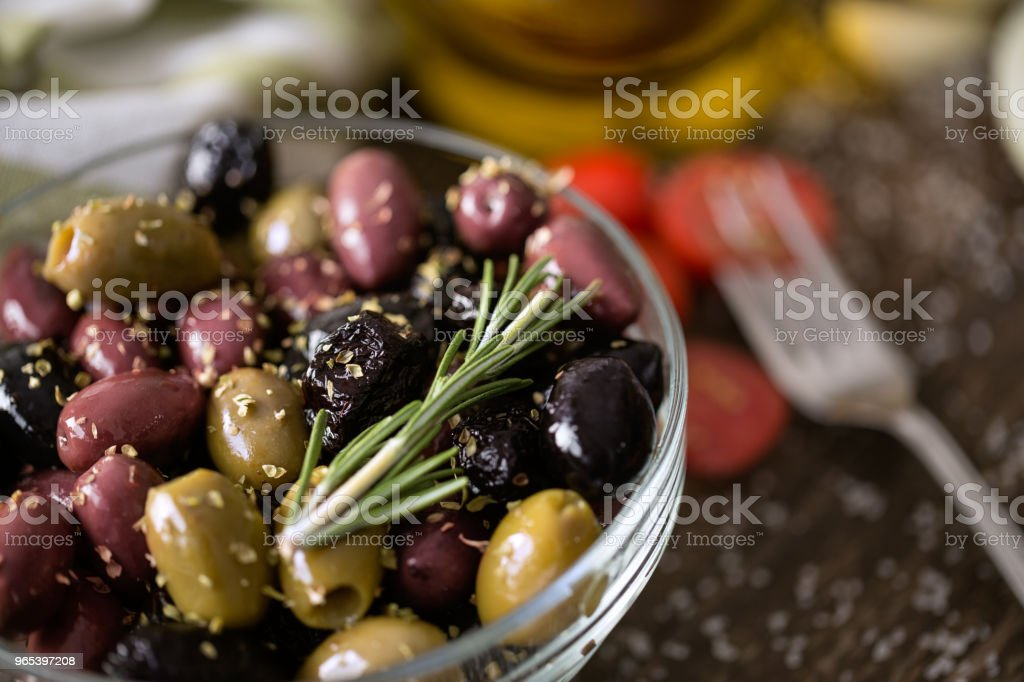 mix of olives in oil with spices royalty-free stock photo