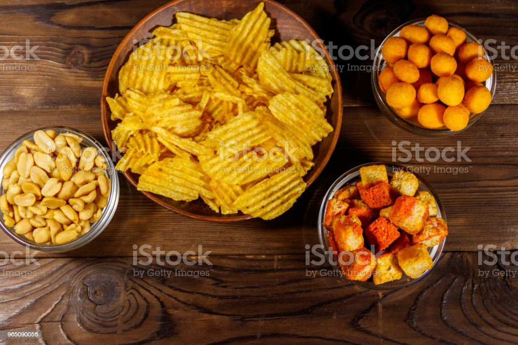 Mix of snacks for beer on wooden table zbiór zdjęć royalty-free