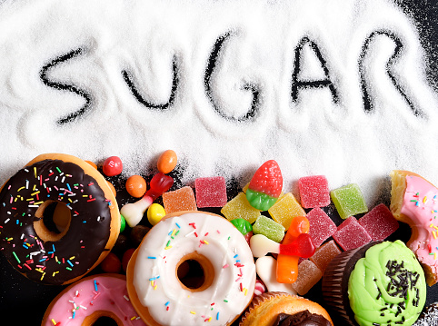 Mix Of Sweet Cakes Donuts And Candy With Sugar Text Stock Photo - Download Image Now