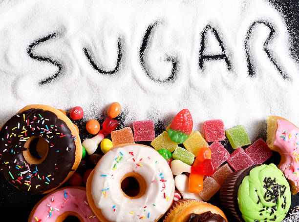 mix of sweet cakes, donuts and candy with sugar text stock photo