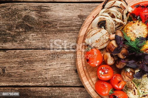 istock Mix of tasty grilled vegetables on wood background 655793486