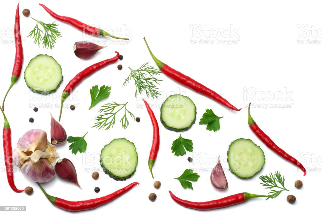mix red hot chili peppers with parsley and sliced cucumber and garlic isolated on white background top view stock photo