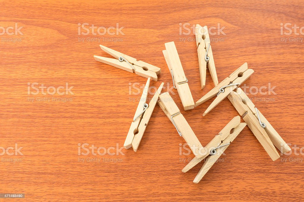Mix Wood Clothespins on Red Wood Surface stock photo