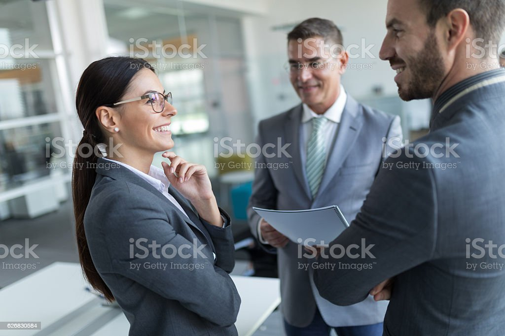 Mixed age business people working on some innovative ideas stock photo