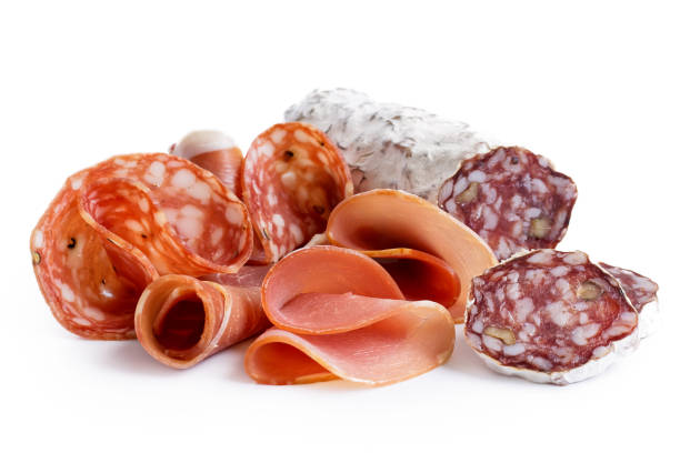 Mixed air cured sliced meats isolated on white. stock photo