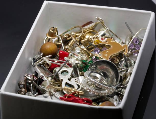 Mixed and Odd box of jewellery stock photo