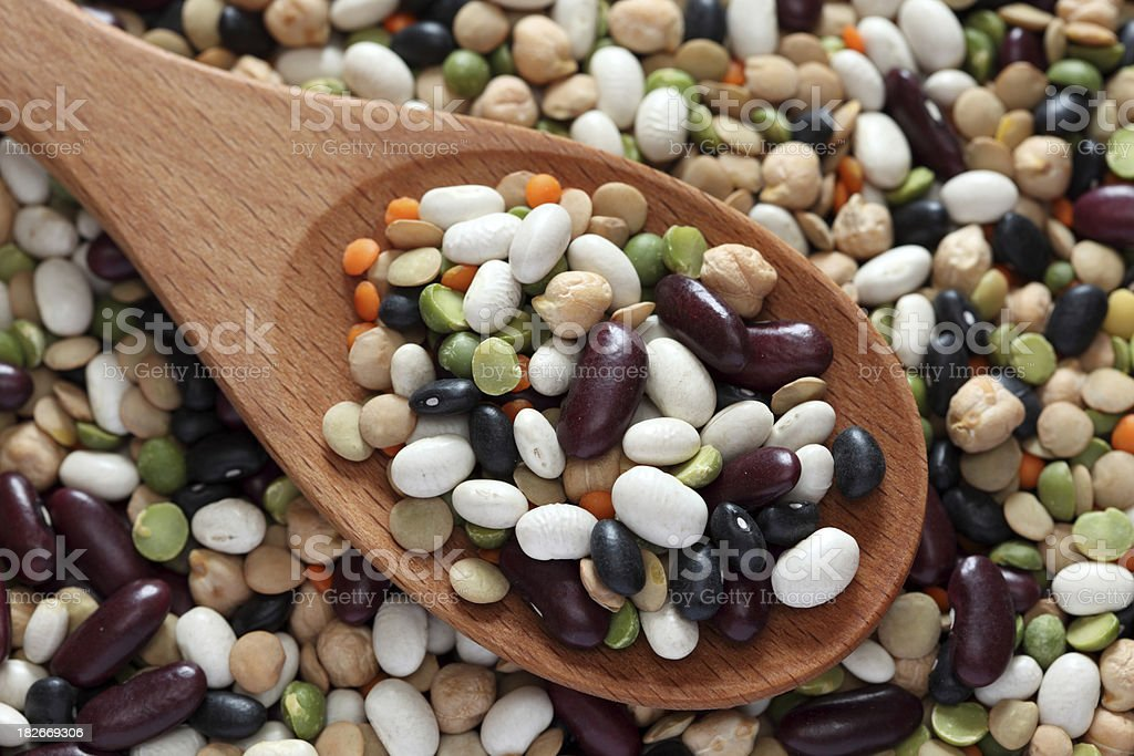 Mixed beans in a wooden spoon royalty-free stock photo