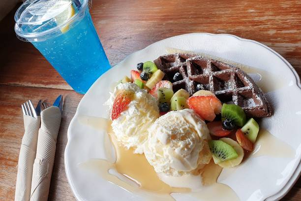 Mixed berries ice cream waffle and blue soda – zdjęcie