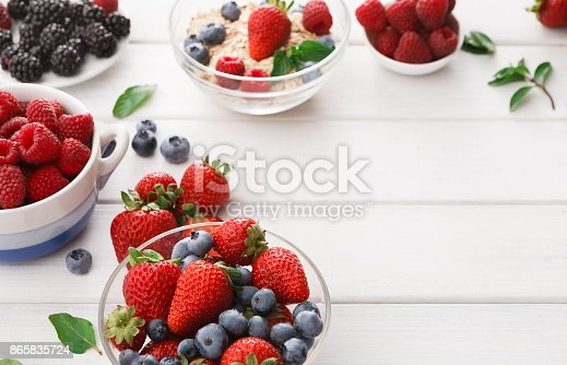 862604802 istock photo Mixed berries in glass bowls closeup, selective focus 865835724