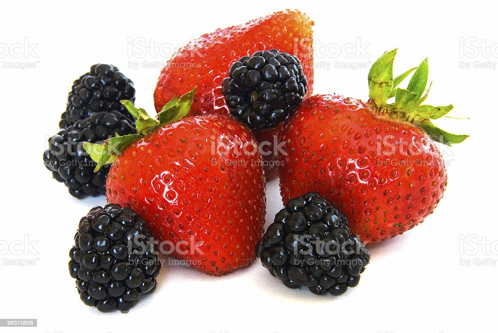 Mixed berries - strawberries and  blackberries on white royalty-free stock photo
