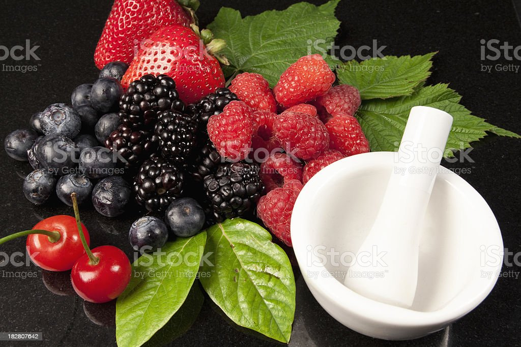 Mixed Berries with Mortar and Pestle royalty-free stock photo