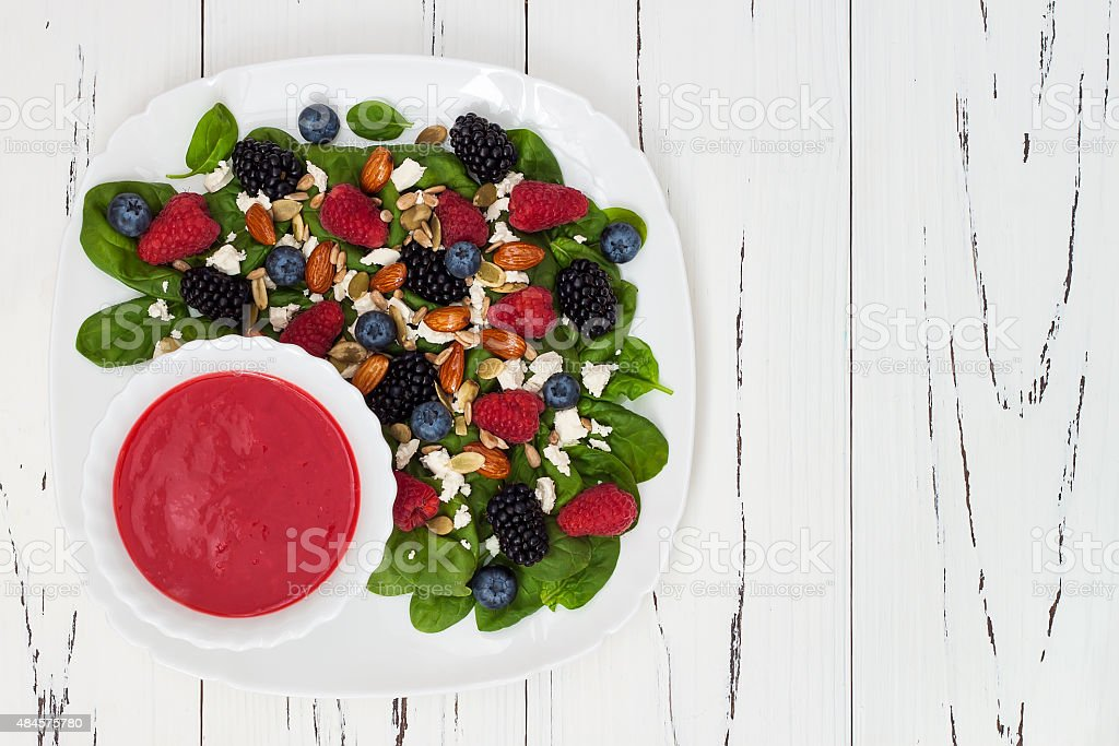 Mixed berry salad with almonds, feta cheese and raspberry vinaigrette stock photo