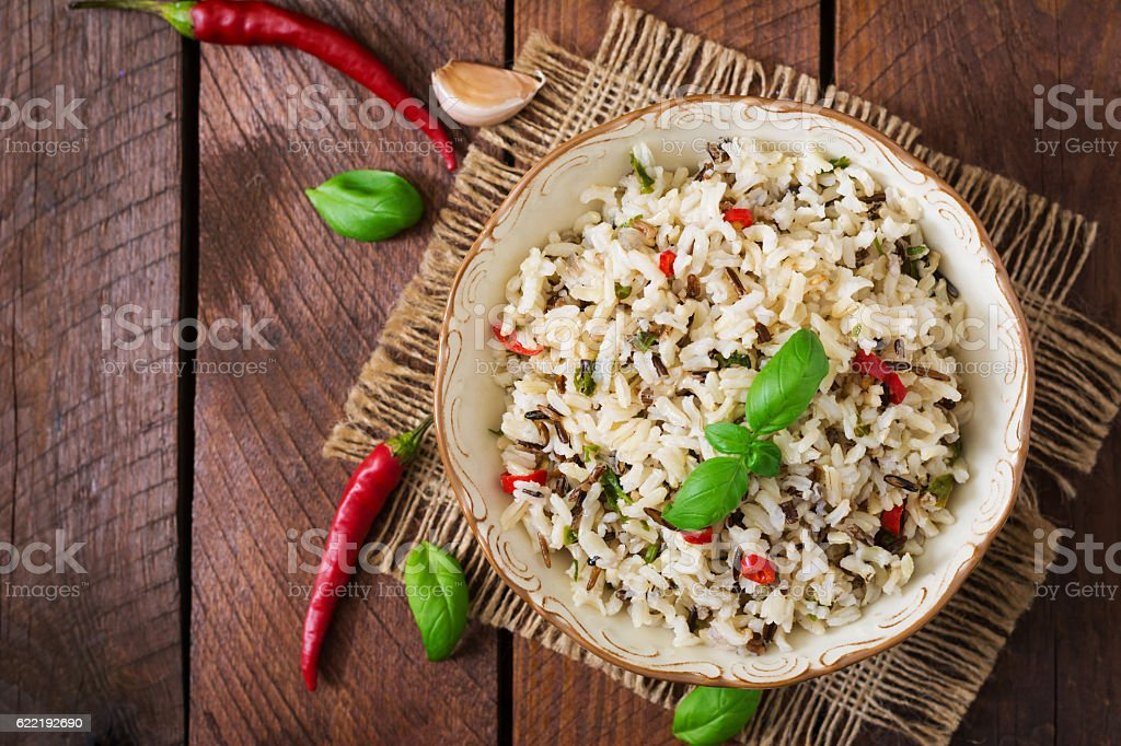 Mixed boiled rice with chilli and basil. Dietary menu. stock photo