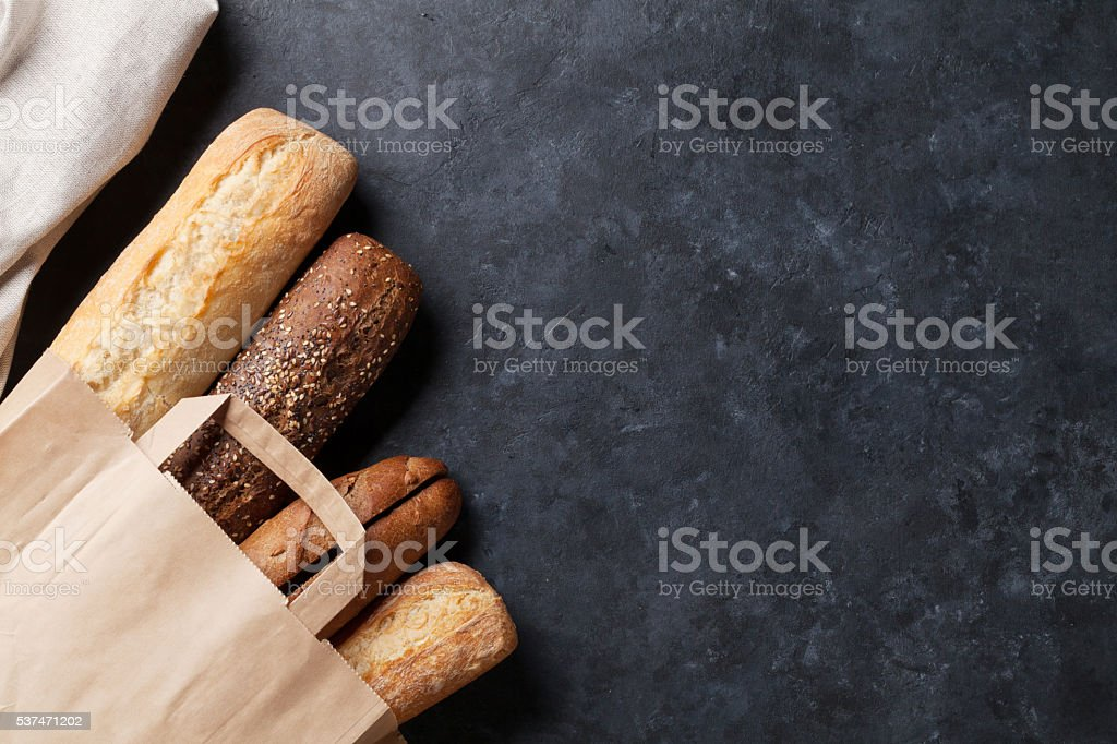Mixed breads on stone table stock photo