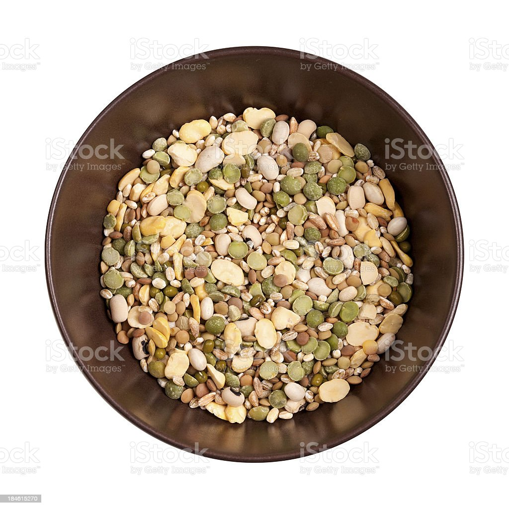 Mixed cereals inside brown bowl with white background, from top stock photo