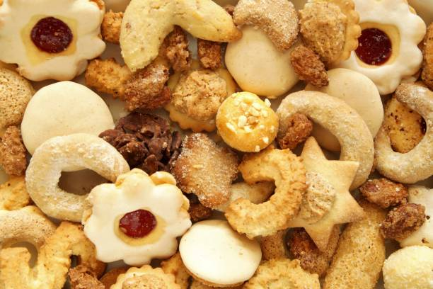 Mixed Christmas cookies. Christmas festive homemade decorated sweets and cookie background stock photo