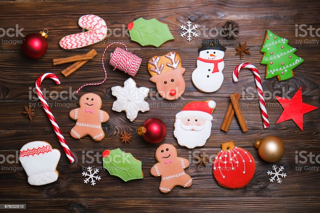 Mixed Christmas cookies Colorful mix of Christmas-themed decorated cookies top view on wooden table stock photo