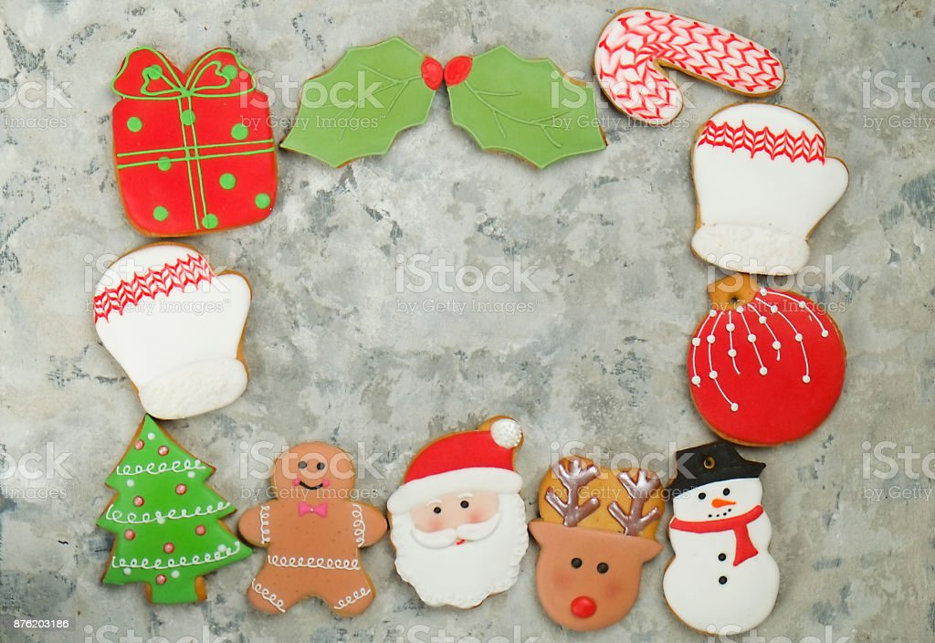 Mixed Christmas cookies Colorful mix of Christmas-themed decorated cookies top view on gray concrete texture table. stock photo