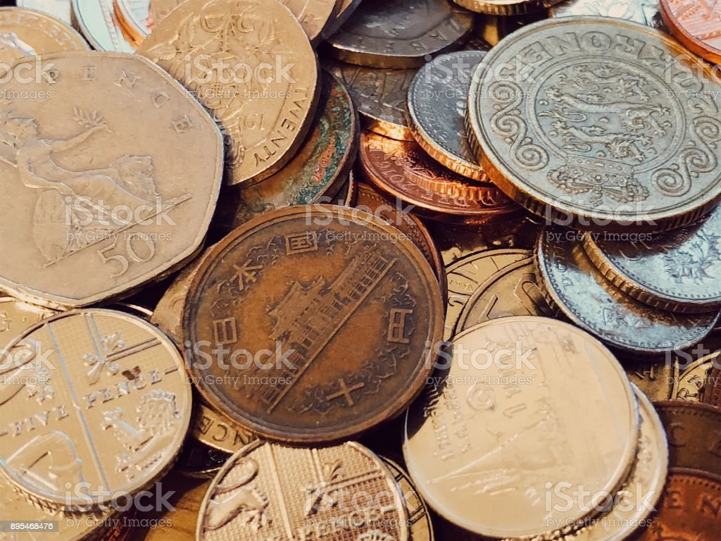 Mixed coins of the world stock photo