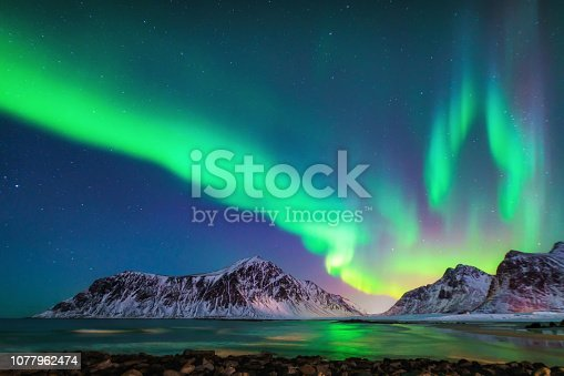 istock Mixed colorful aurora borealis dancing in the sky 1077962474
