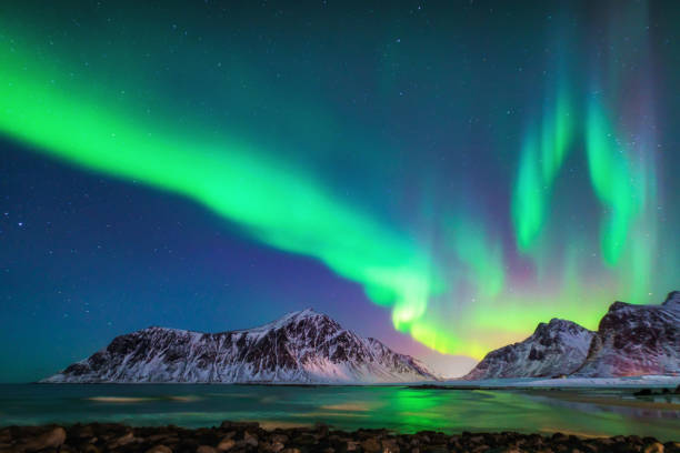 mixed colorful aurora borealis dancing in the sky - clima polar imagens e fotografias de stock