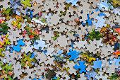 Mixed colour puzzle pieces. Backgrounds.
