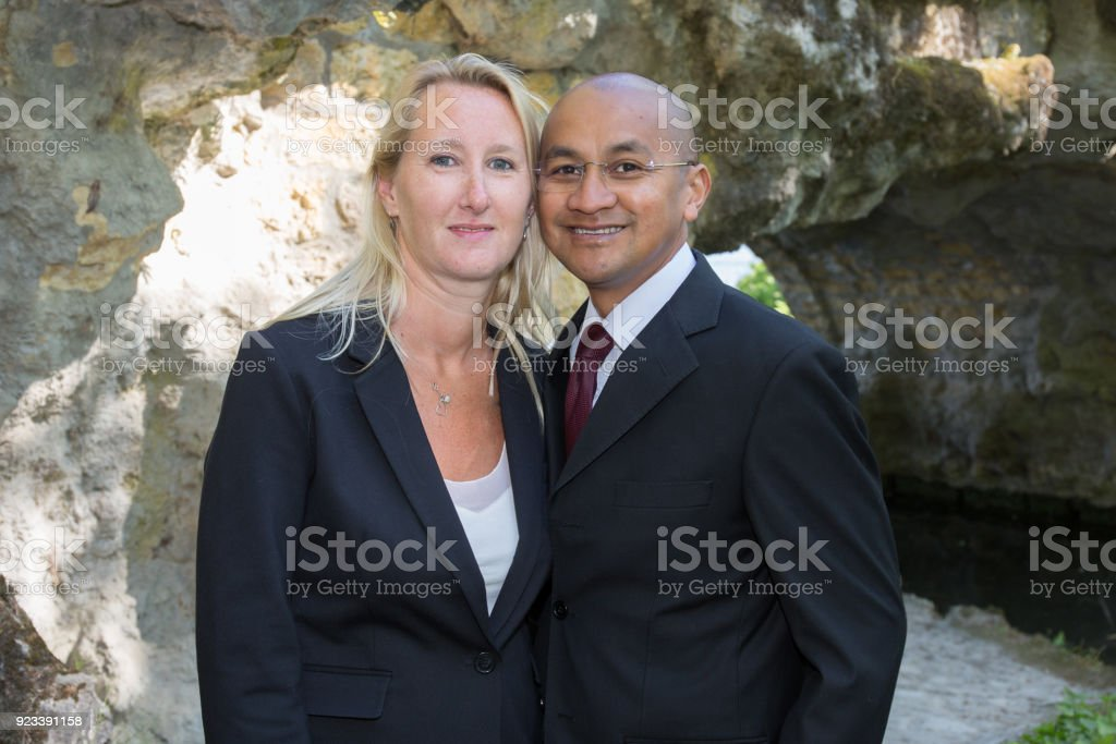30 mixed couple blond girl and south american man stock photo