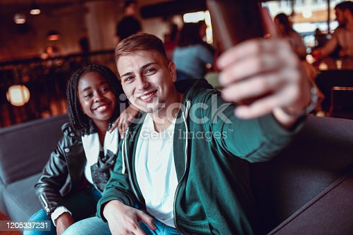 Mixed Couple Enjoying Time Spent Together And Taking Selfie