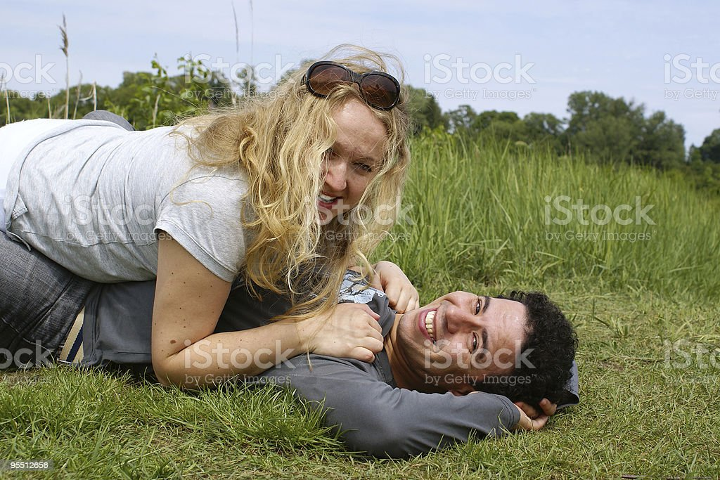Mixed couple resting outdoor stock photo