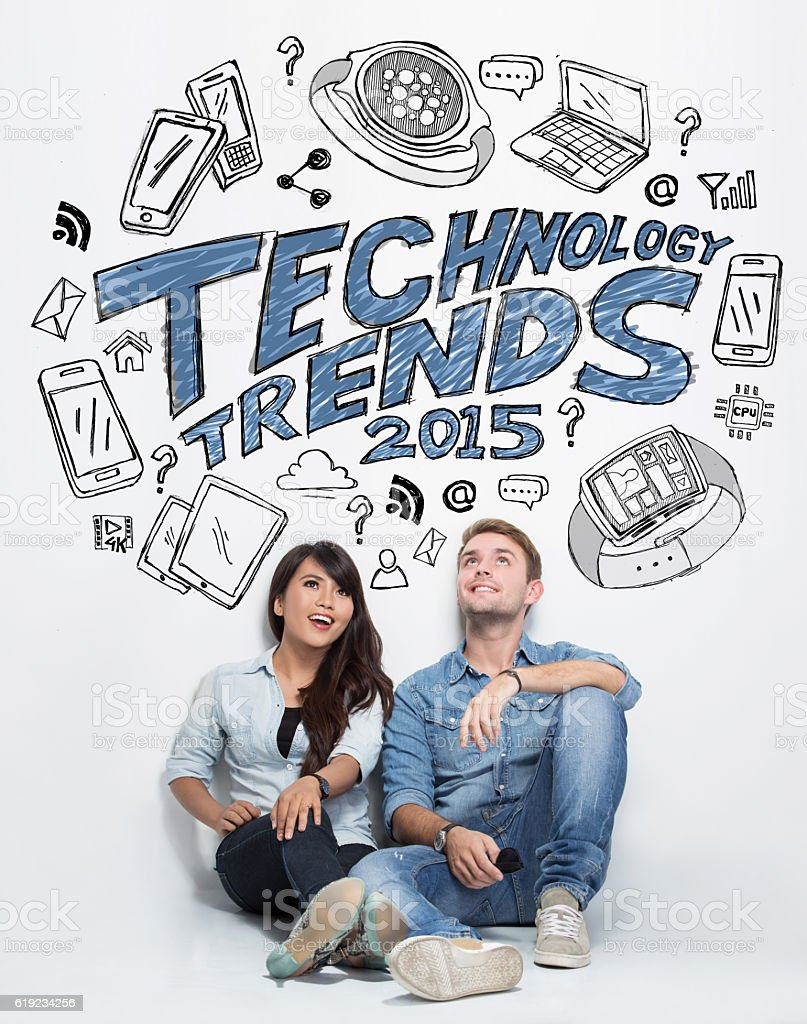 Mixed couple thinking about technology trends, illustrated thing stock photo