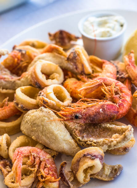 Mixed deep-fried fish, shrimp and squid platter Mixed deep-fried fish, shrimp and squid platter mollusk stock pictures, royalty-free photos & images