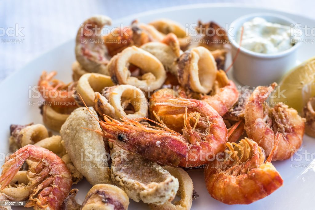 Mixed deep-fried fish, shrimp and squid platter stock photo
