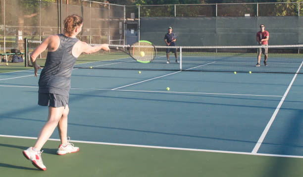 Mixed doubles tennis lessons stock photo