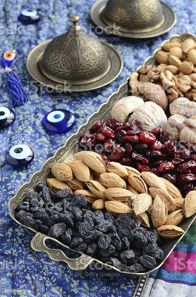 Mixed dried fruits and nuts in oriental style stock photo