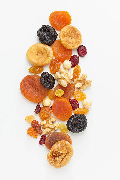 mixed dried fruits and nuts - dried fruit stock photos and pictures