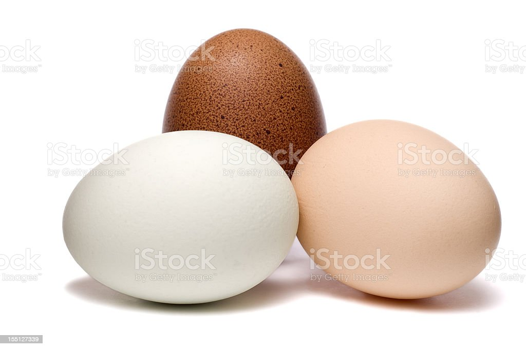 Mixed eggs on white background stock photo