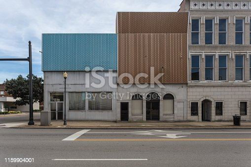 Mixed era architecture on corner of small downtown in obscure part of the midwest with clear sky