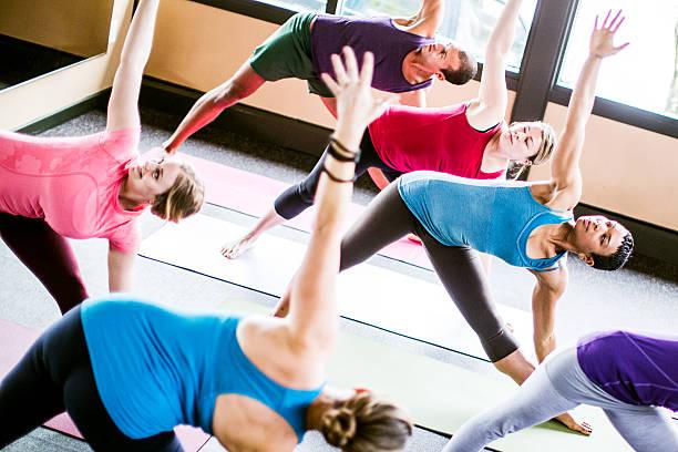 Mixed Ethnic Yoga Class in Studio stock photo